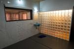 Modern bathroom with glass cube wall